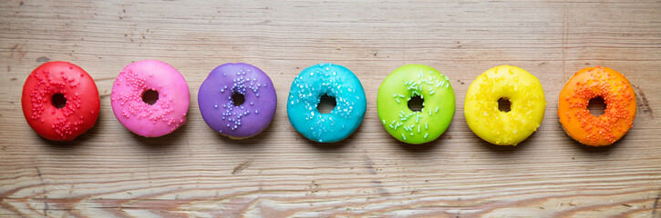 Wall Mural - Row of colorful donuts