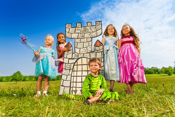 Wall Mural - Girls as princesses and boy in monster costume