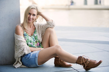 woman in shorts sitting outside