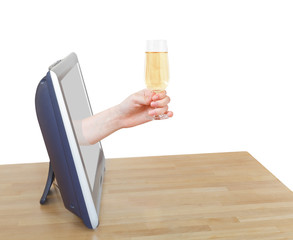 hand holds glass with sparkling wine leans out TV