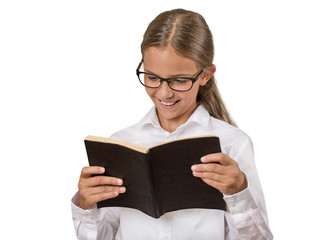 Girl with glasses reading book isolated on white background