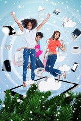 Composite image of three cute women jumping on a tablet pc