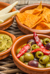 Tapas, marinated olives, tortilla chips, guacamole, manchego