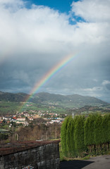 Rainbow over small village and the fields, Galicia, Spain