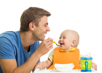 smiling baby eating food