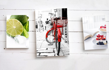 Three images on white wooden wall