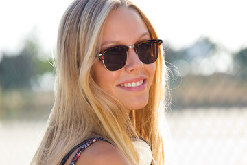 Young attractive woman with sunglasses on a summer day.