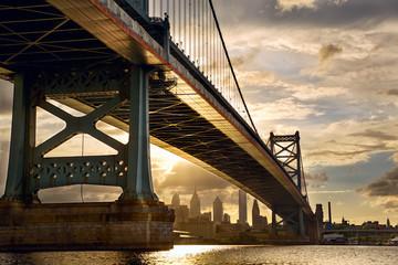 Ben Franklin Bridge above Philadelphia skyline at sunset, US