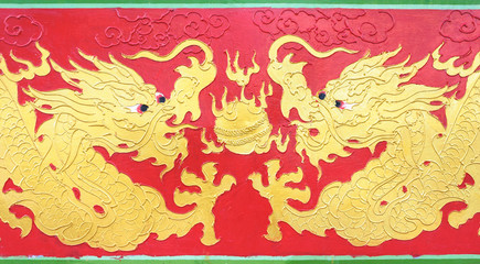 Double golden dragon painting playing fire ball on red backgroun