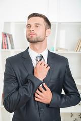 Waist-up portrait of handsome businessman
