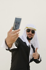 Arab man taking selfie