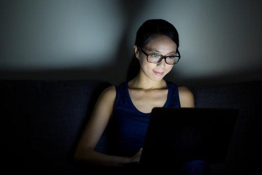 Woman use laptop computer at night