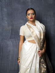 Young pretty woman in indian white dress