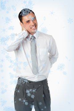 Portrait of a young businessman having a back pain