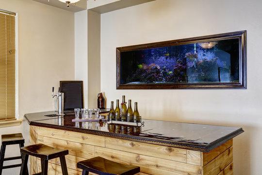 Bar with aquarium. Luxury home interior
