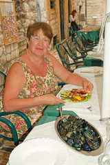 Lunch in a fish restaurant on the street in Dubrovnik