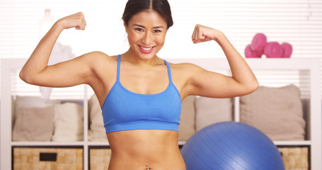 Strong Japanese woman showing off muscles