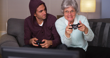 Crazy grandma beating her grandson at videogames