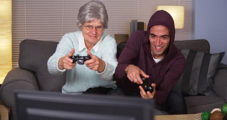Elderly woman playing videogames with Hispanic man