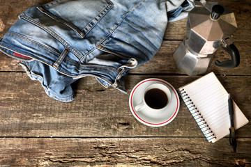 Espresso coffee, espresso maker, notepad and dirty jeans