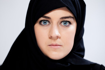 Close-up of scared muslim woman