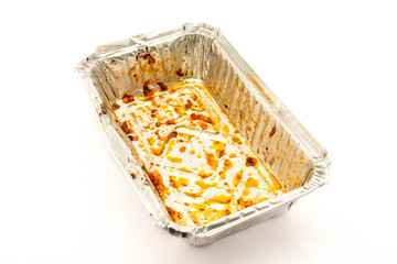 Empty aluminium foil tray after eat on a white background