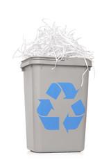 Recycle bin full of shredded paper