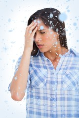 Composite image of woman with a headache and hand on forehead