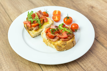 Italian Bruschetta Sandwich With Bacon, Rucola And Tomatoes
