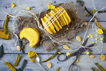 homemade biscuits with pumpkin cream on wooden background