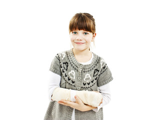 Child with broken arm. Isolated on white background