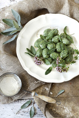 homemade spinach dumplings with sage and flowers
