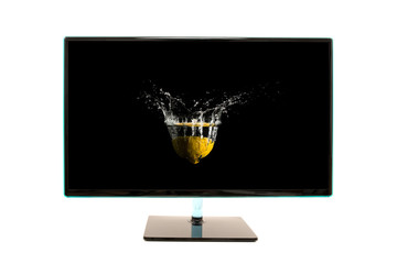 Modern black computer monitor with motion splash