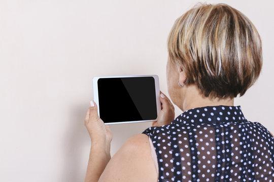 Digital tablet using by senior woman