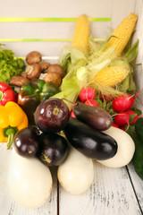 Vegetables on white wooden box background