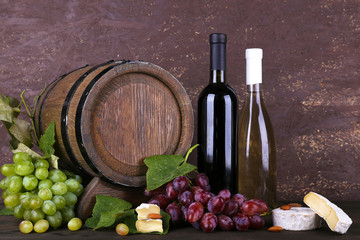 Wine in bottles and in goblet, Camembert and brie cheese,