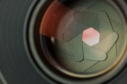 Aperture blades inside of a lens