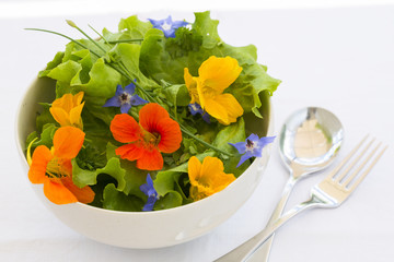 Summer fresh flowors salad in bowl