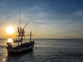 The fishing boat on the sea in the morning.