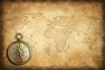 Wall Mural - old brass or golden compass with world map background