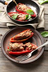 Delicious stuffed peppers on plate on table close-up