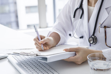 doctors are writing medical records