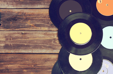 top view of records over wooden table