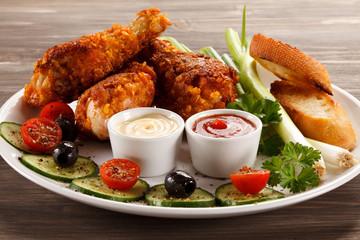 Grilled chicken drumsticks and vegetables