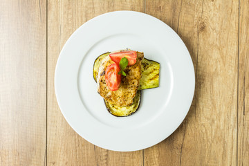 Grilled Eggplant Slice With Pork Chop And Sliced Tomatoes Plate