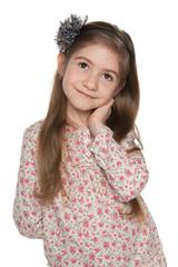 Thoughtful pretty little girl