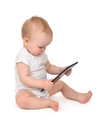 Infant child baby toddler sitting and typing digital tablet mobi