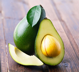 Ripe avocado on a wooden.