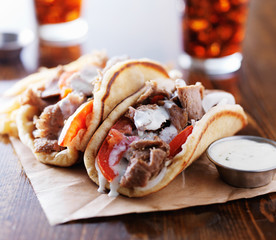 greek gyros with tzatkiki sauce and fries