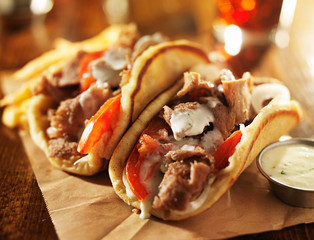 greek gyros with tzatkiki sauce and fries close up